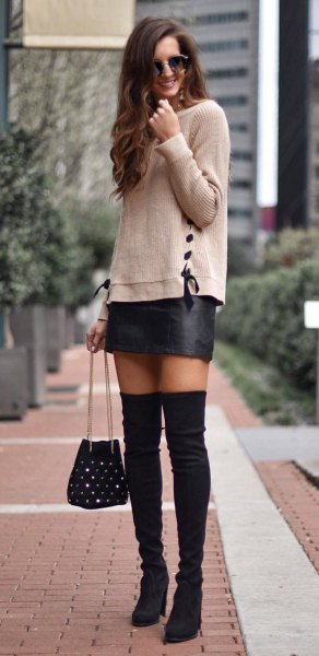 gray knitted sweater with black mini leather skirt