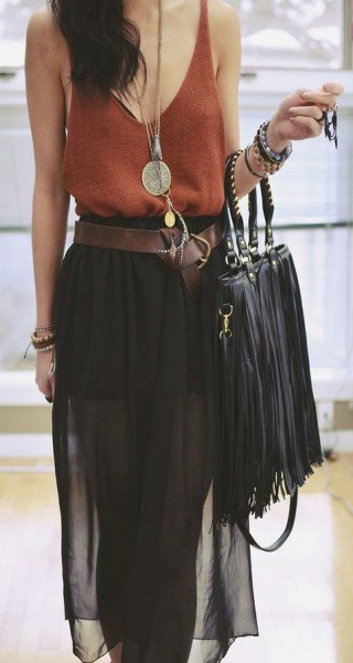 green vest top with bucket neck with black chiffon midi skirt and leather bag