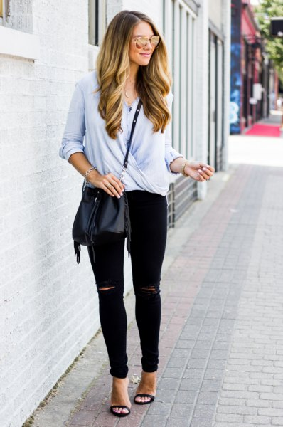 light blue casual wrap blouse with black ripped slim jeans and heels with open toe