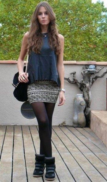 gray sleeveless top with tribal printed skirt and socks