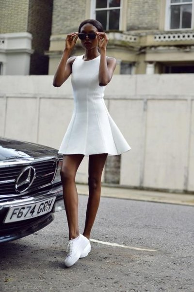 white sleeveless fit and flare mini dress with tennis platform shoes
