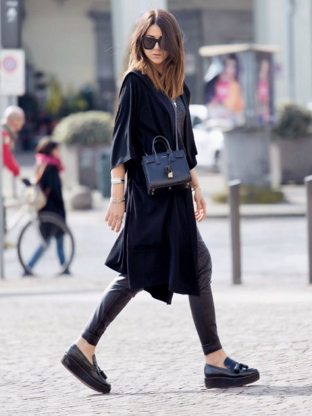 black wide half warm tunic dress with leather pants and platform shoe