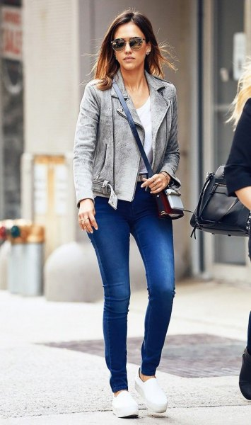 gray mock blazer with blue jeans and white slip on platform shoe