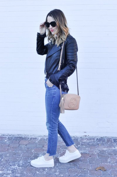 black biker leather jacket with blue jeans and white platform shoe