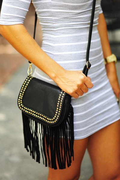 light gray and white striped half-heated mini dress with black leather shoulder bag