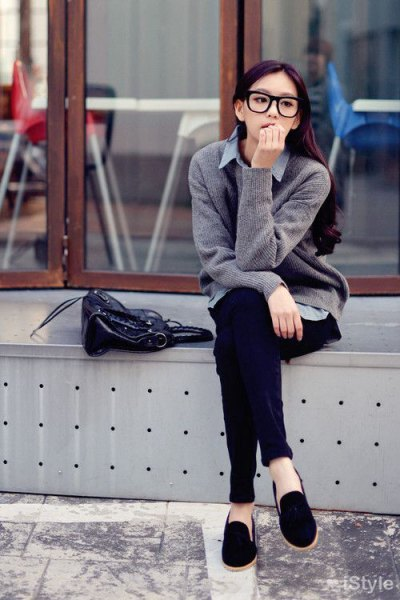 gray knitted sweater cardigan with light blue chambray shirt and black suede loafers