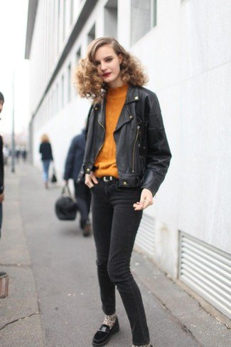 mustard yellow sweater with black leather jacket and dark gray skinny jeans