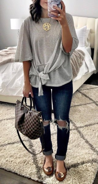 knotted wide neck warm striped tee with heavily ripped skinny jeans