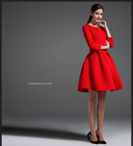 red long-sleeved mini-dress with black ballet heels