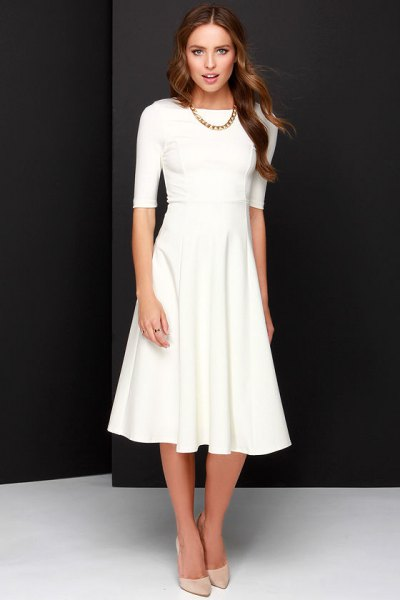 white half-heated fit and flare midi dress with light pink heels