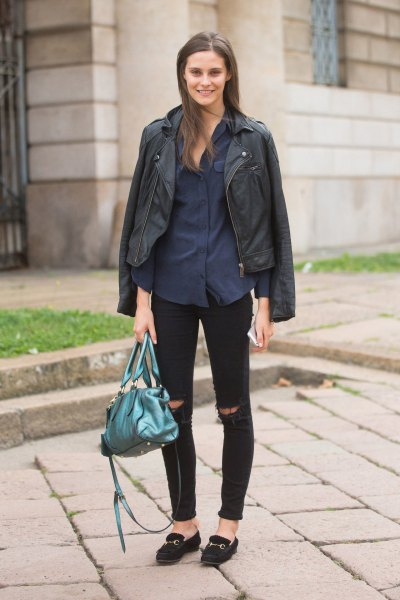 black leather jacket with dark blue button up shirt