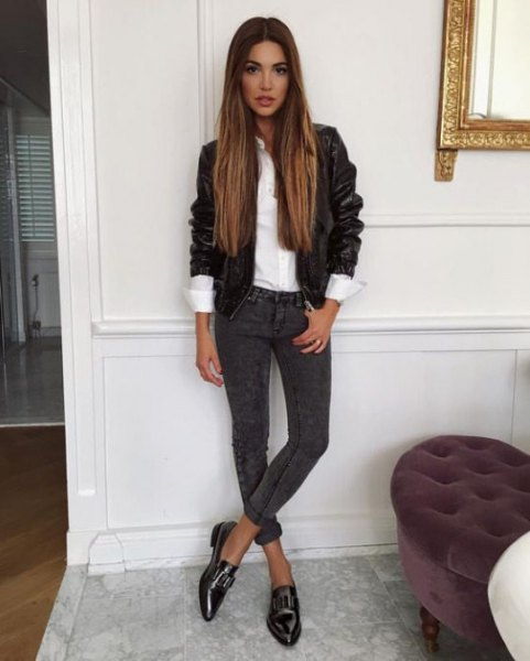 black leather jacket with white shirt and dark gray cuffed skinny jeans