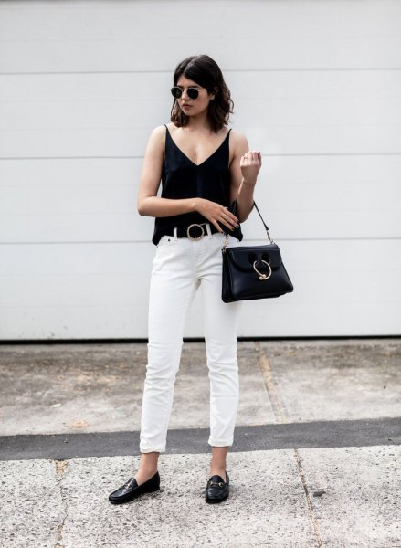 black v-neck vest with white cuff straight leg pants and bread