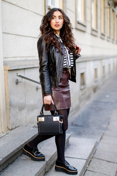 black motorcycle jacket with leather skirt and platform links