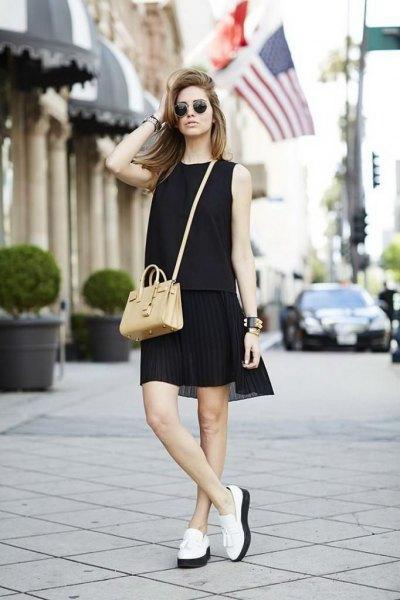 black sleeveless mini-shift dress with white platform links