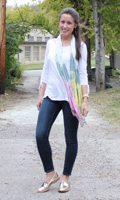 white three-quarter sleeved t-shirt with skinny jeans and golden boards
