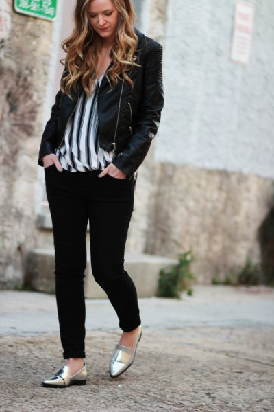 black casual blazer with vertically striped chiffon blouse and metal boards