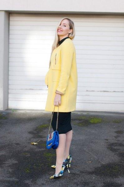 light yellow long wool coat with black knit length dress