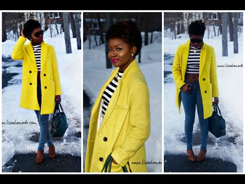 light yellow double breasted coat with black and white striped tee