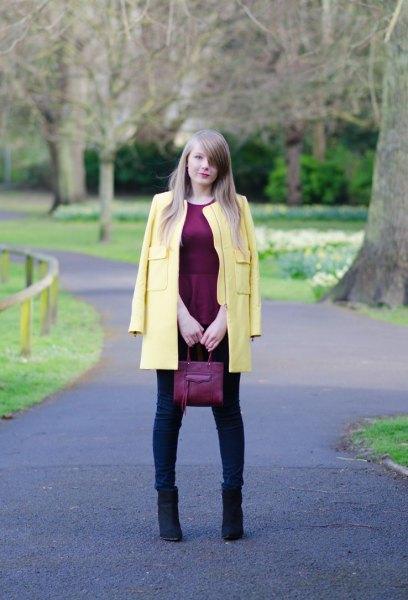 pale yellow coat with black silk peplum top