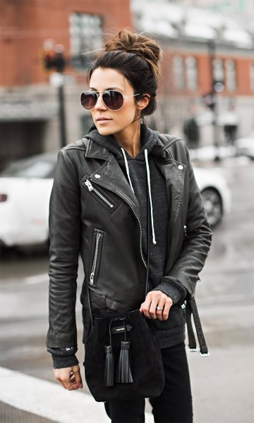 wears moto leather jacket with hoodie