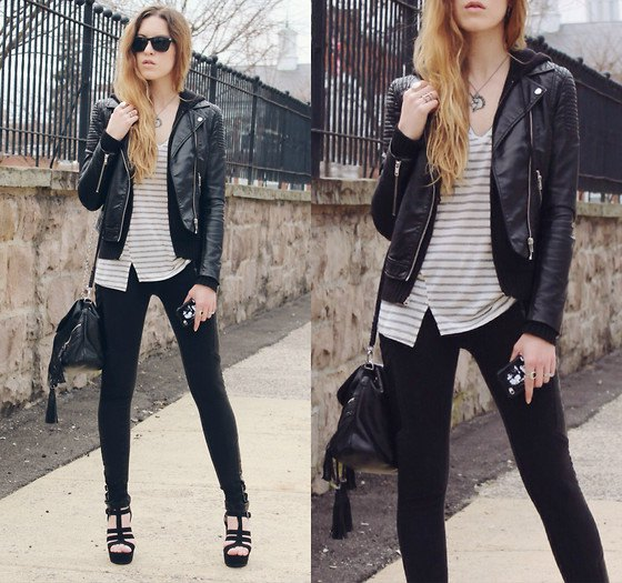 fitted moto jacket with gray and white striped topped v-neck and slim jeans