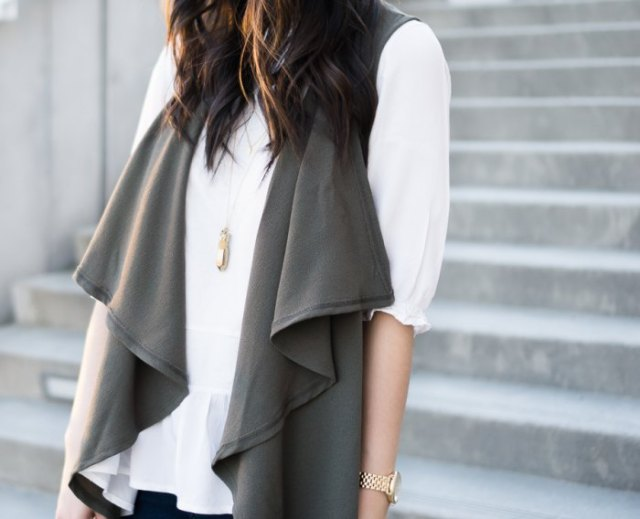 gray sleeveless waterfall jacket with white half-heated blouse