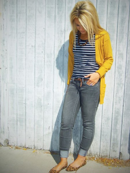 yellow sweater jacket with black and white striped tank top