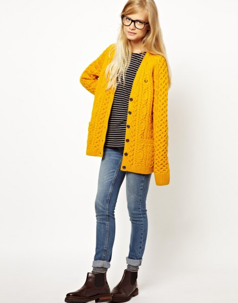 mustard yellow knitted cardigan with cuffed jeans and leather shoes