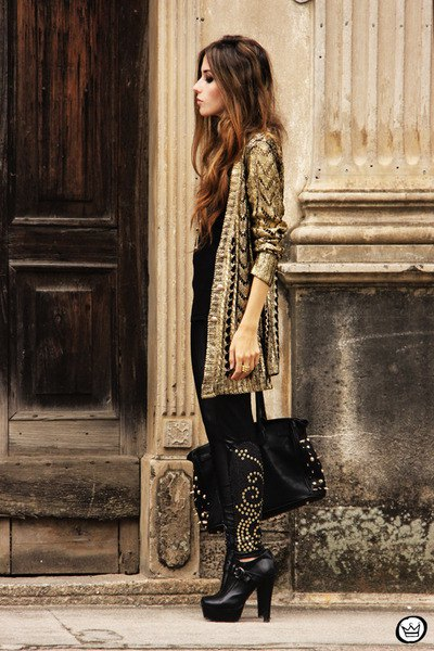 gold and black sequin cardigan with slim jeans and heeled boots