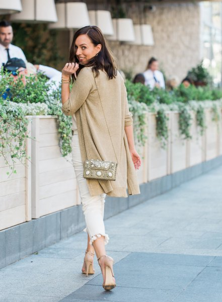 golden long line sweater cardigan with white cropped slim fit jeans