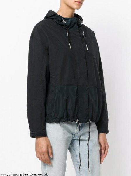 black windbreaker with light blue straight jeans