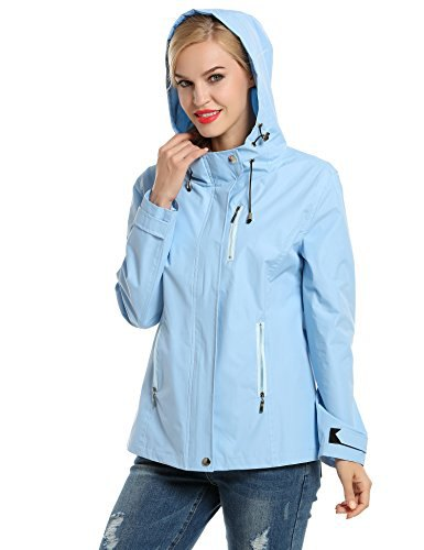 light sky blue nylon sports jacket with ripped jeans