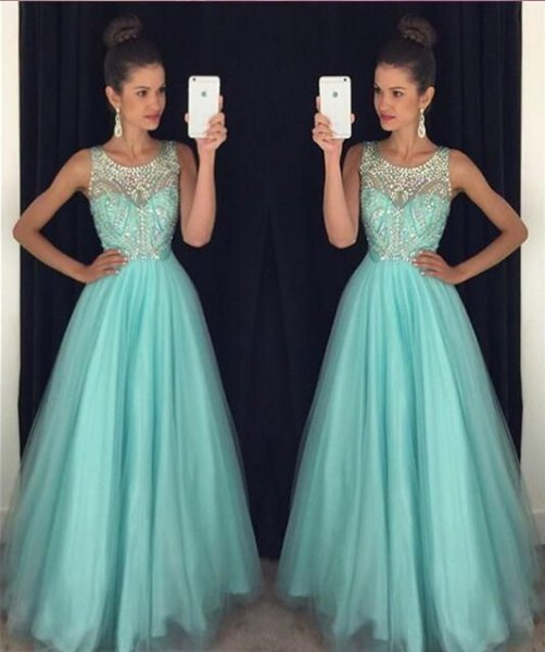 white and turquoise fit and flare pleated floor length dress