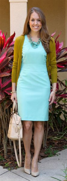 green cardigan with light blue overall waist dress