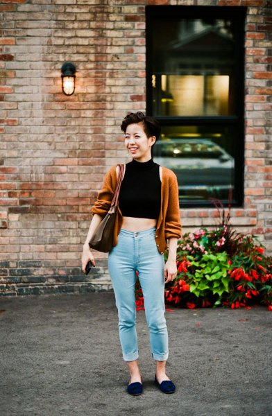 black mock neck cut top with lime green cardigan and mom jeans