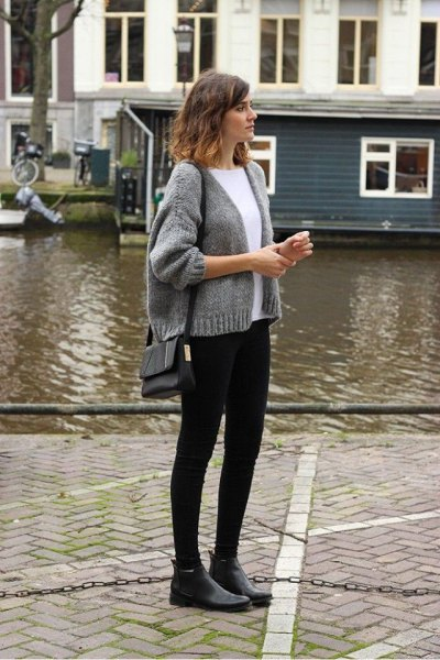 gray short knit cardigan with crew neck sweater and black skinny jeans