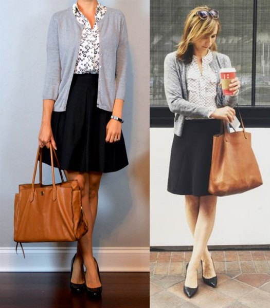 light gray cardigan with white printed shirt and black elongated knee length skirt