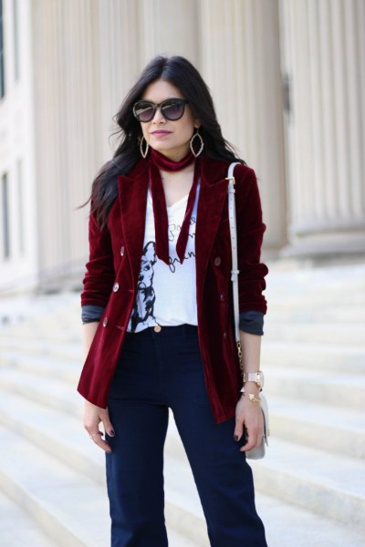 burgundy corduroy blazer with white print v-shirt and navy trousers
