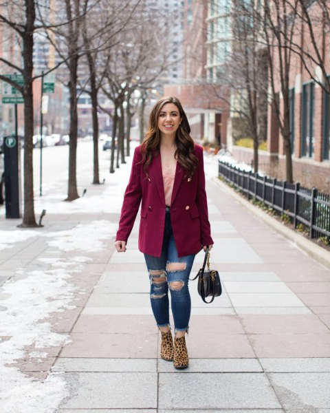 red oversized double breasted blazer with heavily ripped jeans