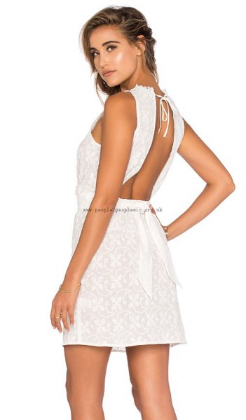 white mini crochet dress with matching heeled sandals