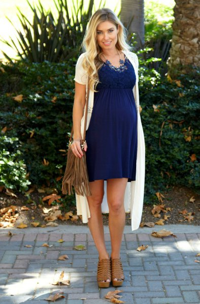 white short-sleeved long knit cardigan with blue mother dress