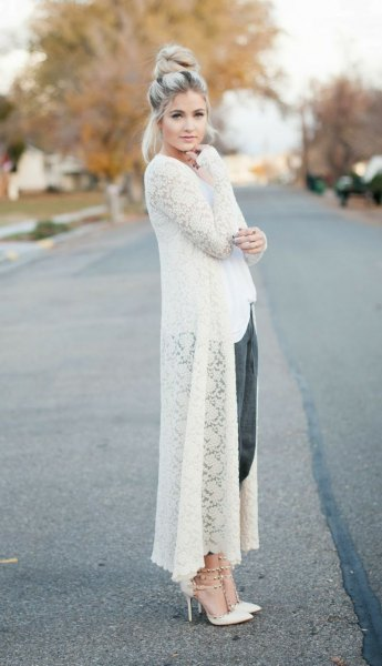 white maxi crocheted sweater cardigan with black cropped pants