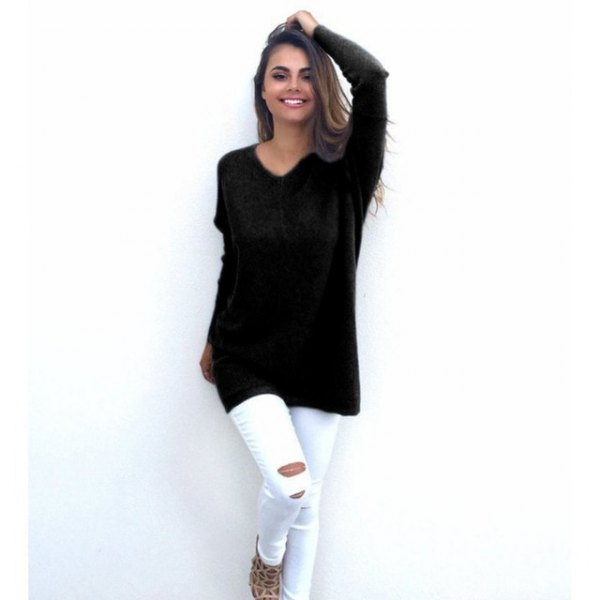 black sweater with v-neck and white ripped skinny jeans