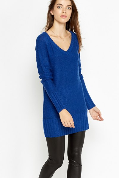 royal blue t-shirt with v-neck sweater with black leather leggings