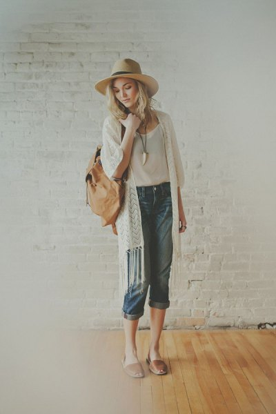 white fringed longline cardigan with white straw hat and pink pink sandals