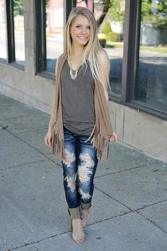 sleeveless fringed cardigan with ripped boyfriends