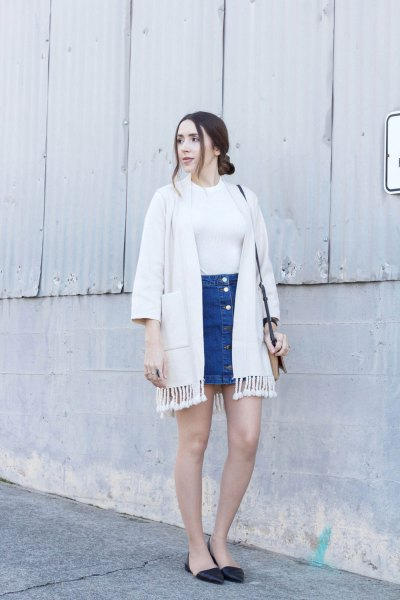 white fringed jacket with blue mini denim skirt