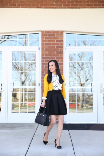 mustard yellow cropped cardigan with white and black polka dot blouse