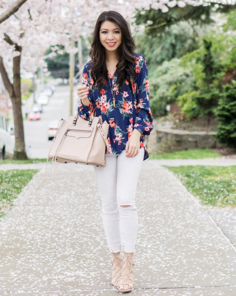 navy blue floral printed button up shirt with white jeans